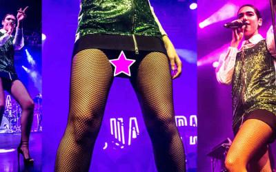 Dua Lipa upskirt fishnet pantyhose – Performs live in Milan