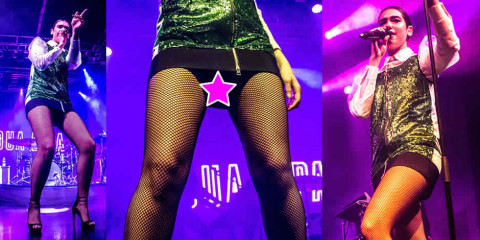 Dua Lipa upskirt fishnet pantyhose – Performs live in Milan
